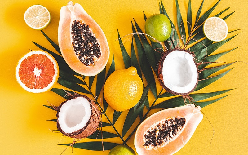tropical fruits on a yellow background